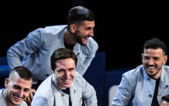 Marco Verratti, Federico Chiesa, Lorenzo Pellegrini e Alessandro Florenzi con le divise della Nazionale firmate Giorgio Armania