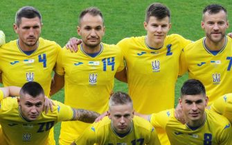 epa09253710 Ukrainian national soccer team players wearing their new jerseys line up for the International Friendly soccer match against Cyprus in Kharkiv, Ukraine, 07 June 2021. Ukraine's new soccer kit for the UEFA EURO 2020 displays a map of Ukraine on the chest including the Crimea peninsula, which was annexed by Russia in 2014. The UEFA has approved the new jerseys of the Ukrainian national team, which are also reading 'Glory to Ukraine!' on the back and 'Glory to the Heroes!' inside.  EPA/SERGEY KOZLOV