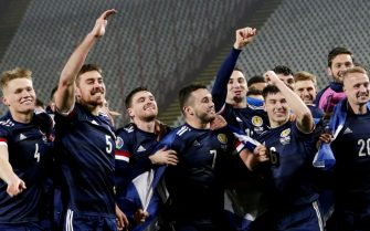 epa08816827 Scotland's players celebrate after winning the penalty shootout of the UEFA EURO 2020 qualification playoff match between Serbia and Scotland in Belgrade, Serbia, 12 November 2020.  EPA/ANDREJ CUKIC