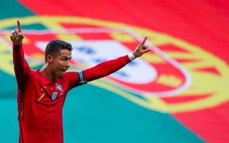 epa09258484 Portugal's Cristiano Ronaldo celebrates after scoring during the international friendly soccer match between Portugal and Israel, in preparation for the upcoming UEFA EURO 2020 tournament, at Alvalade Stadium in Lisbon, Portugal, 09 June 2021.  EPA/MANUEL DE ALMEIDA