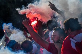 Turkey's fans holding flare bombs arrive at the Olympic stadium on June 11, 2021 in Rome prior to the kick off of Turkey vs Italy, opening the UEFA Euro 2020 2021 European Football Championship. (Photo by Tiziana FABI / AFP) (Photo by TIZIANA FABI/AFP via Getty Images)