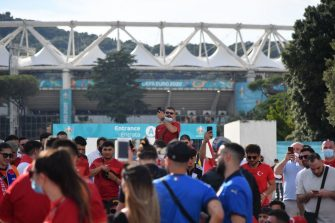Turkey's and Italy's fans arrive to the Olympic stadium on June 11, 2021 in Rome prior to the kick off of Turkey vs Italy, opening the UEFA Euro 2020 2021 European Football Championship. (Photo by Tiziana FABI / AFP) (Photo by TIZIANA FABI/AFP via Getty Images)