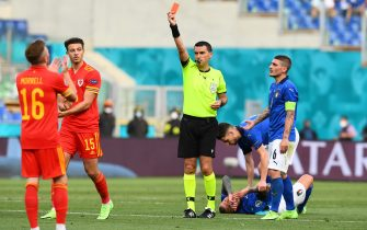 ROME, ITALY - JUNE 20: Ethan Ampadu of Wales reacts as he is shown a red card by Match Referee, Ovidiu Hategan during the UEFA Euro 2020 Championship Group A match between Italy and Wales at Olimpico Stadium on June 20, 2021 in Rome, Italy. (Photo by Claudio Villa/Getty Images)