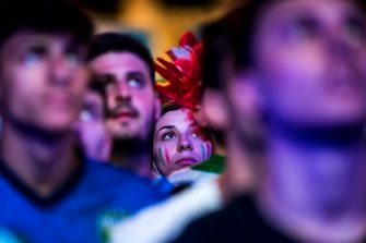 Italian National Team supporters watch the UEuro 2020 quarter-final match Belgium vs Italy on the giant screen set up in Popolo square, Rome, Italy, 02 July 2021.  ANSA/ANGELO CARCONI