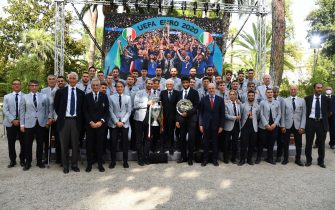 ROME, ITALY - JULY 12:  President of Italy Sergio Mattarella poses for photo with the Italian national men's football team during the meeting between President of Italy Sergio Mattarella and the Italian national football team after their July 11 win against England in the Euro 2020 championship final on July 12, 2021 in Rome, Italy.  (Photo by Claudio Villa/Getty Images)