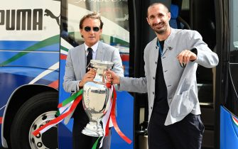 Italy's coach Roberto Mancini (L) and Italy's defender Giorgio Chiellini carry the UEFA EURO 2020 trophy as players and staff of Italy's national football team arrive to attend a ceremony at the Quirinale presidential palace in Rome on July 12, 2021, a day after Italy won the UEFA EURO 2020 final football match between Italy and England. (Photo by Vincenzo PINTO / AFP) (Photo by VINCENZO PINTO/AFP via Getty Images)