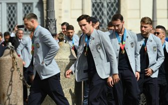 (From L) Italy's midfielder Federico Bernardeschi, Italy's midfielder Federico Chiesa, Italy's midfielder Gaetano Castrovilli and Italy's forward Ciro Immobile arrive as players and staff of Italy's national football team come to attend a ceremony at the Quirinale presidential palace in Rome on July 12, 2021, a day after Italy won the UEFA EURO 2020 final football match between Italy and England. (Photo by Vincenzo PINTO / AFP)