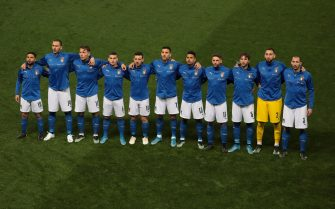 PARMA, ITALY - MARCH 25: Italy team line up for the anthems prior to the FIFA World Cup 2022 Qatar qualifying match between Italy and Northern Ireland on March 25, 2021 in Parma, Italy. (Photo by Emilio Andreoli/Getty Images)