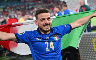 epa09338930 Alessandro Florenzi of Italy celebrates winning the UEFA EURO 2020 final between Italy and England in London, Britain, 11 July 2021.  EPA/Paul Ellis / POOL (RESTRICTIONS: For editorial news reporting purposes only. Images must appear as still images and must not emulate match action video footage. Photographs published in online publications shall have an interval of at least 20 seconds between the posting.)