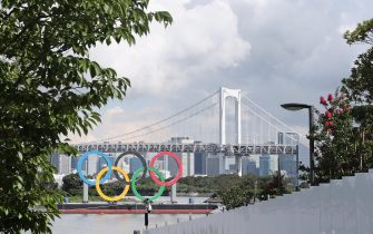 epa09347504 An Olympic rings monument in the Japanese capital's Odaiba waterfront area, with the Rainbow Bridge in the background, in Tokyo, Japan, 16 July 2021. The Tokyo Olympics, which have been postponed for a year due to the coronavirus pandemic, will run from 23 July through 08 August 2021.  EPA/YONHAP SOUTH KOREA OUT