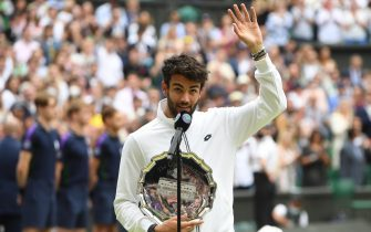 epa09337855 Matteo Berrettini of Italy waves while holding the runners-up trophy after loosing the men's final against Novak Djokovic of Serbia at the Wimbledon Championships, Wimbledon, Britain 11 July 2021.  EPA/NEIL HALL   EDITORIAL USE ONLY