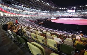 epa09359426 A photographer set up a remote camera in an empty stadium without spectator before the Opening Ceremony of the Tokyo Olympic Games at the Olympic Stadium in Tokyo, Japan, 23 July 2021.  EPA/LAURENT GILLIERON EDITORIAL USE ONLY