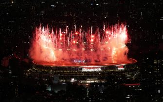 epa09359460 Picture taken from the Shibuya Sky observation deck shows fireworks going off at the start of the Opening Ceremony of the Tokyo 2020 Olympic Games at the Olympic Stadium in Tokyo, Japan, 23 July 2021.  EPA/CHRISTOPHER JUE
