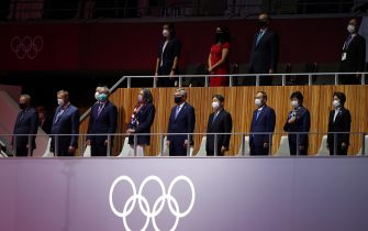 epa09359501    Japanese Emperor Naruhito (4-R) accompanied by the President of the International Olympic Committee Thomas Bach (5-L) attend the Opening Ceremony of the Tokyo 2020 Olympic Games at the Olympic Stadium in Tokyo, Japan, 23 July 2021.  EPA/RITCHIE B. TONGO