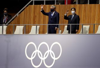 epa09359485   Japanese Emperor Naruhito (R) accompanied by the President of the International Olympic Committee Thomas Bach (L) wave during the Opening Ceremony of the Tokyo 2020 Olympic Games at the Olympic Stadium in Tokyo, Japan, 23 July 2021.  EPA/RITCHIE B. TONGO