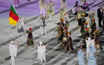 epa09359729 The Cameroon team parade during the Opening Ceremony of the Tokyo Olympic Games at the Olympic Stadium, in Tokyo, Japan, 23 July 2021.  EPA/JOE GIDDENS NO ARCHIVING, EDITORIAL USE ONLY, IMAGES TO BE USED FOR NEWS REPORTING PURPOSES ONLY, NO COMMERCIAL USE WHATSOEVER, NO USE IN BOOKS WITHOUT PRIOR WRITTEN CONSENT FROM AAP AUSTRALIA AND NEW ZEALAND OUT