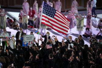 epa09359861 Athletes of the United States of America enter the stadium during the Opening Ceremony of the Tokyo 2020 Olympic Games at the Olympic Stadium in Tokyo, Japan, 23 July 2021.  EPA/KIMIMASA MAYAMA
