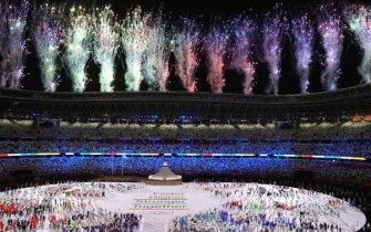 TOKYO, JAPAN - JULY 23: A general view of Fireworks as the athletes watch on during the Opening Ceremony of the Tokyo 2020 Olympic Games at Olympic Stadium on July 23, 2021 in Tokyo, Japan. (Photo by Laurence Griffiths/Getty Images)