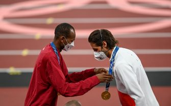 Tokyo , Japan - 2 August 2021; Joint gold medalists Mutaz Essa Barshim of Qatar, left, and Gianmarco Tamberi of Italy during the Men's High Jump Victory Ceremony at the Olympic Stadium on day ten of the 2020 Tokyo Summer Olympic Games in Tokyo, Japan. (Photo By Ramsey Cardy/Sportsfile via Getty Images)