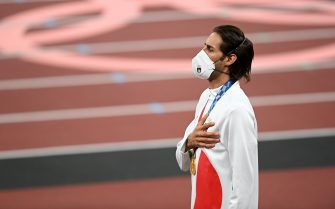 Tokyo , Japan - 2 August 2021; Joint gold medalist Gianmarco Tamberi of Italy stands for the national anthem during the Men's High Jump Victory Ceremony at the Olympic Stadium on day ten of the 2020 Tokyo Summer Olympic Games in Tokyo, Japan. (Photo By Ramsey Cardy/Sportsfile via Getty Images)