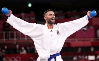 epa09401036 Luigi Busa of Italy celebrates after defeating Rafael Aghayev of Azerbaijan during the Men's Kumite -75kg Gold Medal Bout during the Karate events of the Tokyo 2020 Olympic Games at the Nippon Budokan arena in Tokyo, Japan, 06 August 2021.  EPA/HEDAYATULLAH AMID