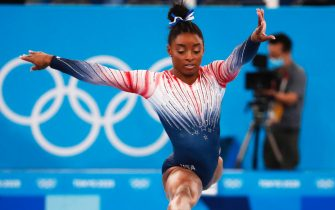 epa09390609 Simone Biles of the USA competes in the Women's Balance Beam Final during the Artistic Gymnastics events of the Tokyo 2020 Olympic Games at the Ariake Gymnastics Centre in Tokyo, Japan, 03 August 2021.  EPA/TATYANA ZENKOVICH