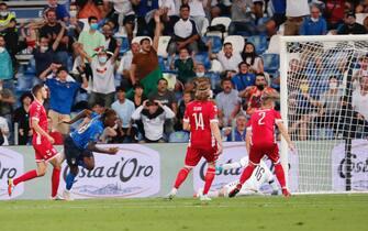 L'attaccante Moise Kean in azione con la maglia della Nazionale