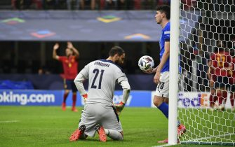 MILAN, ITALY, OCTOBER 06: Gianluigi Donnarumma (L), goalkeeper of Italy, and his teammate Alessandro Bastoni (R), react after Ferran Torres, of Spain, not pictured, scored during the UEFA Nations League football tournament semi-final match between Italy and Spain at San Siro stadium in Milan, Italy, on October 06, 2021. (Photo by Isabella Bonotto/Anadolu Agency via Getty Images)