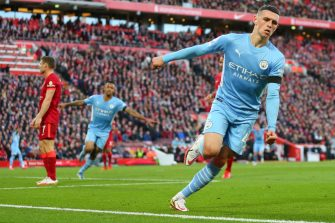 LIVERPOOL, ENGLAND - OCTOBER 03: Phil Foden of Manchester City celebrates after scoring a goal to make it 1-1 during the Premier League match between Liverpool and Manchester City at Anfield on October 3, 2021 in Liverpool, England. (Photo by Robbie Jay Barratt - AMA/Getty Images)