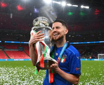 LONDON, ENGLAND - JULY 11: Jorginho of Italy celebrates with The Henri Delaunay Trophy following his team's victory in the UEFA Euro 2020 Championship Final between Italy and England at Wembley Stadium on July 11, 2021 in London, England. (Photo by Claudio Villa/Getty Images)
