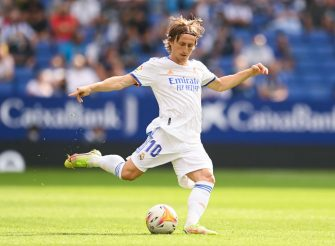 BARCELONA, SPAIN - OCTOBER 03: Luka Modric of Real Madrid CF runs with the ball during the La Liga Santander match between RCD Espanyol and Real Madrid CF at RCDE Stadium on October 03, 2021 in Barcelona, Spain. (Photo by David Ramos/Getty Images)