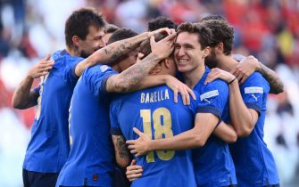 Italy's midfielder Nicolo Barella celebrates with teammates after scoring during the UEFA Nations League third place football match between Italy and Belgium, at the Juventus Stadium, in Turin, on October 10, 2021. (Photo by Marco BERTORELLO / AFP) (Photo by MARCO BERTORELLO/AFP via Getty Images)