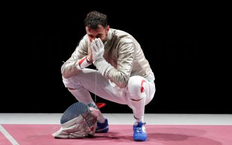 epa09361667 Luigi Samele of Italy reacts after winning the men's Sabre individual semifinal during the Fencing events of the Tokyo 2020 Olympic Games at the Makuhari Messe convention centre in Chiba, Japan, 24 July 2021.  EPA/KIYOSHI OTA