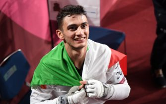 Italy's Vito Dell'Aqulia won first gold for Italy defiting in final Tunisia's Khalil Mohamed Jendoubi during their Taekwondo Men's -58kg match at the Tokyo 2020 Olympic Games at the Makuhari Messe convention centre in Chiba, Japan, 24 July 2021.  ANSA / CIRO FUSCO