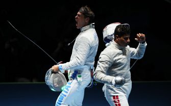 epa05471365 Aldo Montano (L) of Italy celebrates after defeating Fares Ferjani (R) of Tunisia during the men's Sabre individual round of 32 of the Rio 2016 Olympic Games Fencing events at the Carioca Arena 3 in the Olympic Park in Rio de Janeiro, Brazil, 10 August 2016.  EPA/JOSE MENDEZ