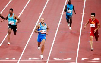 epa09382334 Lamont Marcell Jacobs (C) of Italy competes in the Men's 100m heats during the Athletics events of the Tokyo 2020 Olympic Games at the Olympic Stadium in Tokyo, Japan, 31 July 2021.  EPA/TATYANA ZENKOVICH