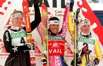 The winners of the World Cup Ski Finals Women's Giant Slalom, Katja Seizinger (L) of Germany, Deborah Compagnoni (C) of Italy and Karin Roten (R) of Switzerland celebrate at the awards ceremony 15 March in Vail, CO.  Compagnoni finished first, Seizinger second and Roten third in the race.   AFP PHOTO/Doug COLLIER (Photo by DOUG COLLIER / AFP)        (Photo credit should read DOUG COLLIER/AFP via Getty Images)
