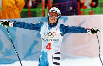 Italy's Deborah Compagnoni raises her arms in victory after winning the Olympic Women's Giant Slalom at Mt. Higashidate in Shigakogen 20 February. Compagnoni went into the Olympic record books after winning her third gold medal in three straight Winter Games.    ANSA/STEPHEN JANSEN