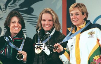 The winners of the Olympic women's slalom, from L to R, silver medalist Deborah Compagnoni of Italy, German gold medalist Hilde Gerg and Australia's bronze medalist Zali Steggall, display their medals at the awards ceremony in Nagano 20 february.     AFP PHOTO/BORIS HORVAT (Photo credit should read BORIS HORVAT/AFP via Getty Images)
