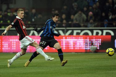 Inter Milan's Argentinian forward Diego Milito (R) evades a tackle by A.C. Milan's midfielder Ignazio Abate and shoots at goal during their Serie A football match Inter Milan vs AC Milan at the San Siro Stadium in Milan on  January 24, 2010. AFP PHOTO / GIUSEPPE CACACE (Photo credit should read GIUSEPPE CACACE/AFP via Getty Images)
