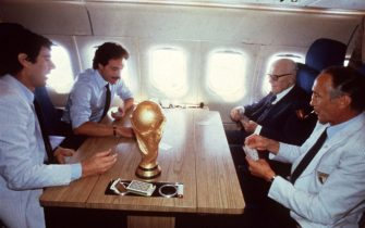 """epa02503812 (FILE) A July 1982 file photo shows former Italian head coach of Italian soccer team, Enzo Bearzot (R), while he palyes cards on the airplane with Italian President Sandro Pertini (II from R) and Italian goalkeeper Dino Zoff (L) after the victory of the 1982 Soccer World Championships. Bearzot, who led the team to the 1982 World Cup title, died on Tuesday, 21 December 2010 aged 83, the Italian football federation (FIGC) said. News reports said that Bearzot was ill for several years and died in Milan. The former Inter Milan player Bearzot was in charge of the Squadra Azzurra for a record 104 matches 1975-1986. The World Cup title 1982 in Spain, 3-1 over West Germany in the final, was his biggest success.     """"The memory of Enzo Bearzot can not be limited to the joy he gave us in 1982 ... Bearzot was able to convey great human and sporting values,"""" said FIGC President Giancarlo Abete.  EPA/STR  ANSA"""