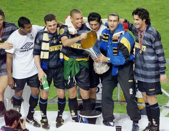 Inter Milan's Brazilian forward Ronaldo (C) and his teammates celebrate with the UEFA Cup on the podium after winning the soccer final against Lazio Rome 3-0, 06 May at the Parc des Princes Stadium in Paris. (ELECTRONIC IMAGE) (Photo credit should read JACK GUEZ/AFP via Getty Images)