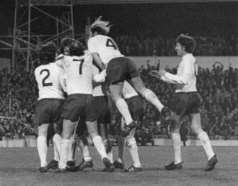 Tottenham Hotspur players congratulate Steve Perryman after his second goal against AC Milan in the UEFA Cup semi-final, first leg, at White Hart Lane, London, 5th April 1972. Spurs won the match 2-1. Among the players are: Joe Kinnear (in number 2 shirt), Alan Gilzean (7) and Ralph Coates (4). (Photo by Central Press/Hulton Archive/Getty Images)