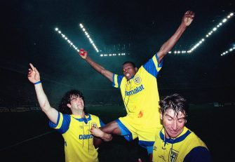 MILAN, ITALY - MAY 17: Parma striker Faustino Asprilla (c) is held aloft by team mates Fernando Coulo and Massimo Crippa (r) after the second leg of the 1995  UEFA Cup Final between Parma and Juventus at the San Siro on May 17, 1995 in Milan, Italy. (Photo by Clive Brunskill/Allsport/Getty Images)