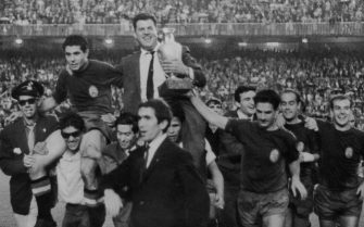 The Spanish football team bear their manager, Jose Villalonga, aloft to celebrate their victory in the European Nations Cup, when they beat the Soviet Union 2-1 at the  Santiago Bernabeu stadium, Madrid, 21st June 1964. (Photo by Central Press/Hulton Archive/Getty Images)