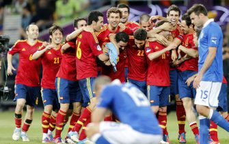 Dejected Italian players (blue shirt) in front of the Spanish team celebrating their victory in the final of the UEFA EURO 2012 between Spain and Italy in Kiev, Ukraine, 01 July 2012. ANSA/SERGEY DOLZHENKO
