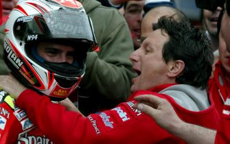 Italian Moto GP rider Marco Melandri (L) of team Fortuna Honda celebrates his win with team manager Fausto Gresini after the Moto GP at Istanbul Park Circuit near of  Istanbul, Turkey on Sunday; 30 April 2006.  ANSA / TOLGA BOZOGLU / PAL