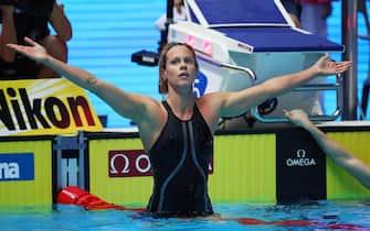 epa07737022 Federica Pellegrini of Italy celebrates after winning the women's 200m freestyle Final during the Swimming events at the Gwangju 2019 FINA World Championships, Gwangju, South Korea, 24 July 2019.  EPA/YONHAP SOUTH KOREA OUT
