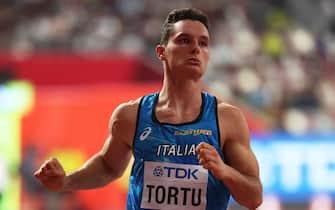 epa07874359 Filippo Tortu of Italy crosses the finish line during the men's 100m heats at the IAAF World Athletics Championships 2019 at the Khalifa Stadium in Doha, Qatar, 27 September 2019. EPA/SRDJAN SUKI