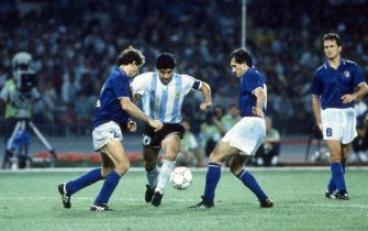 NAPLES, ITALY - JULY 03:  Diego armando Maradona (C) of Argentina  competes for the ball with (l-r9 Franco Baresi and Luigi De Agostini of Italy during the FIFA World Cup 1990 match between Italy and Argentina at Stadio San Paolo on July 03, 1990 in Naples, Italy.  (Photo by Alessandro Sabattini/Getty Images)